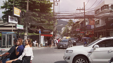 Traffic at an Urban Intersection in Patong. Thailand. with Traffic and Sound Live Action