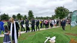 shot of casket being carry to burial site at cemetery Image