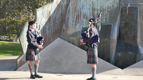 scottish bag piper at a funeral service Footage
