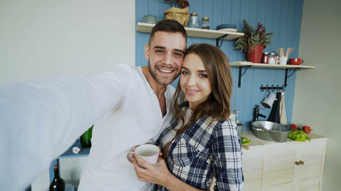 POV of Young happy couple taking selfie photos while having breakfast time in Footage