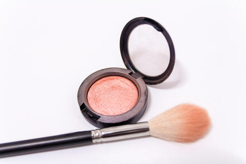 Close up of makeup brush and blush box isolated on white backgro Fotografía