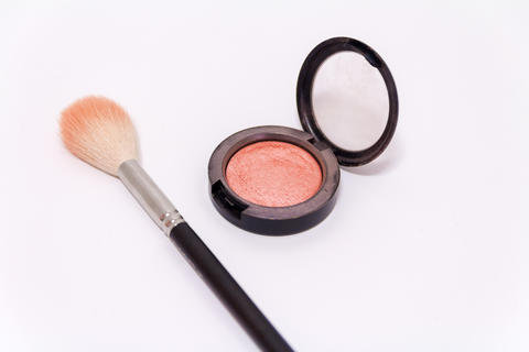 Close up of makeup brush and blush box isolated on white backgro Photo