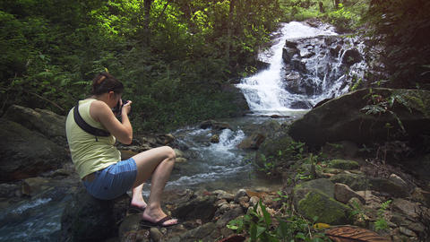 Happy Tourist Photographs Waterfall from Boulder in Stream. with Sound Footage