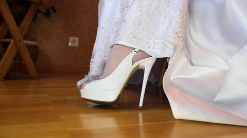 Bride Raises Wedding Dress Baring Feet in Tights Shoes Closeup Footage