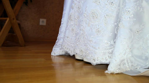 Bride Shows High Heel White Shoes out of Wedding Dress Closeup Footage