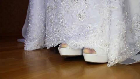 Bride High Heel White Shoes out of Wedding Dress Hem Macro Footage
