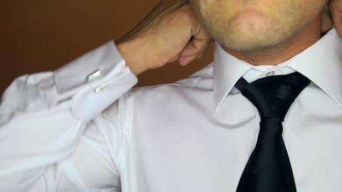 Groom Sets White Shirt Collar with Black Necktie Closeup Image