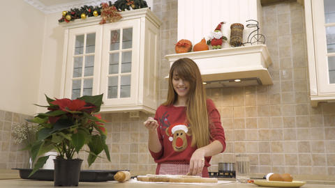 Young girl is cooking the Christmas cookies Footage