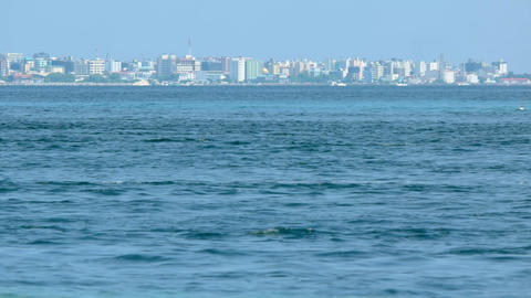 Urban Skyline of Male from Vaadhoo Island. across the Water Live Action