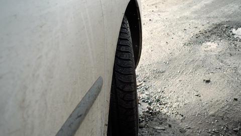 Car tire on a muddy road Archivo