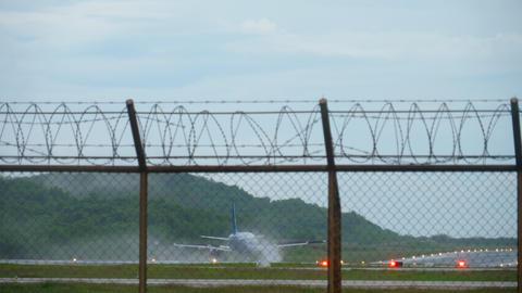 Airplane landing wet runway Footage