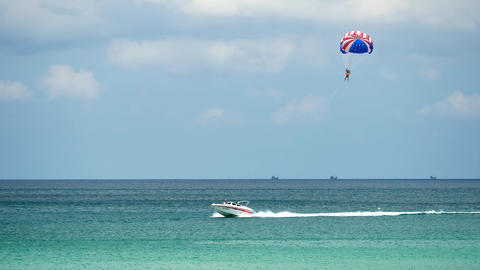 Travel video Speed boat dragging a parachute Footage