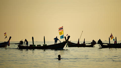 fishermen sailed through group of long-tail boats floating in the andaman sea Archivo