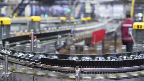 Conveyor belt with glass bottles. The production process of alcoholic beverages Footage