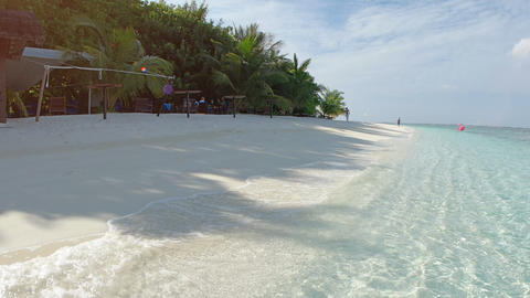 Gentle Waves Lap at Sandy Tropical Beach with Sound Footage