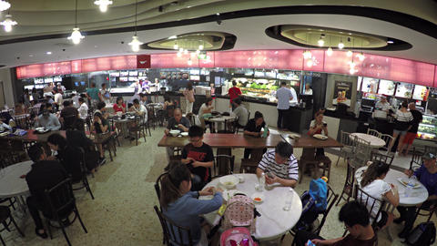 Families Dining at a Food Court inside the Marina Bay Sands Footage