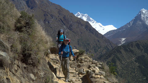 Girls tourist go on the trail in the Himalayas Footage