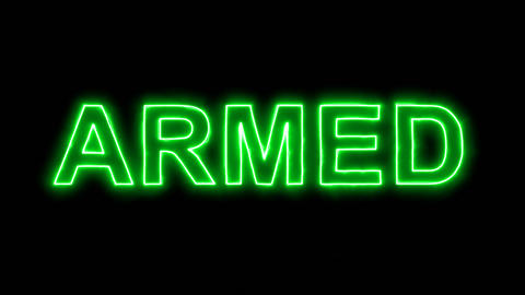 Neon flickering green text ARMED in the haze. Alpha... Stock Video Footage