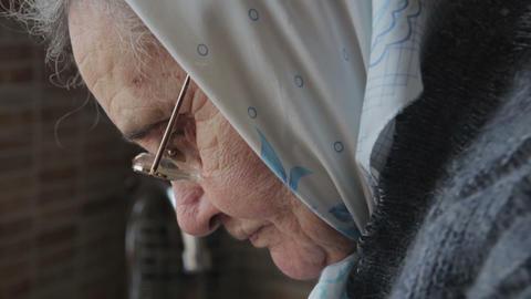 Focused work of elderly woman Footage