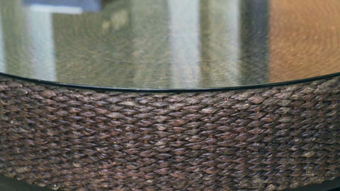 Close up of rattan texture horizontal tracking table with glass top Asian interi Footage