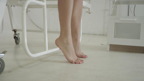 Female Feet Under Hospital Bed stock footage