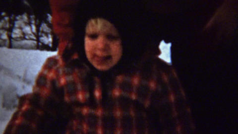 1961: Crying boy falls in snow mom picks up and brushes off Footage