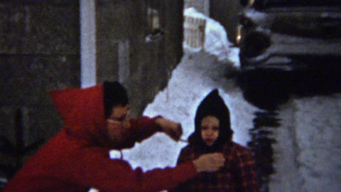 1961: Mother bundling Ralphie for winter snow play like Christmas story movie Footage