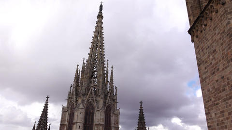 Pan shot bell towers and main spire of Barcelona Cathedral, from building roof Footage