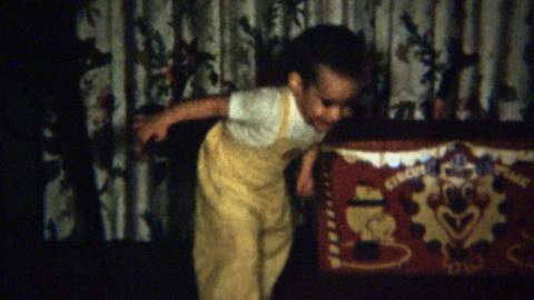 1959: Toddler kicks toy football indoors loves practicing Footage