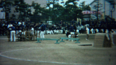 1961: Asian schoolboy obstacle course competition jump race Footage