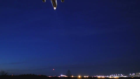 Twilight rear view of a modern jet landing at Narita International airport. W/S Footage