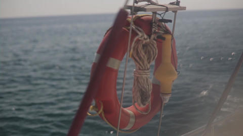 Red Lifebuoy Ring On Ship Railing Footage