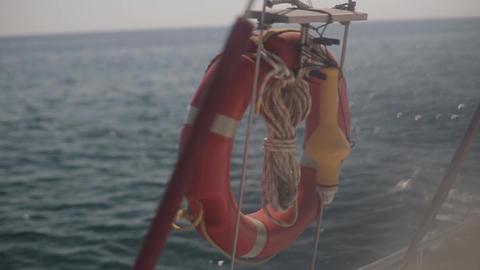 Red Lifebuoy Ring On Ship Railing Footage