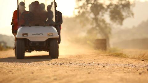 Vehicle on village road Footage