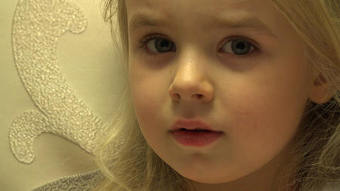 Closeup of Happy Baby Girl Face Looking TV Set Interested. 4K UltraHD, UHD Footage
