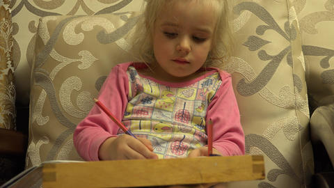 Cute Little Girl Paint Attentively, Big Leg in Frame. 4K UltraHD, UHD Footage