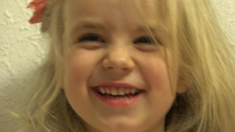 Closeup of Happy Baby Girl Grimace She's Face. 4K UltraHD, UHD Footage