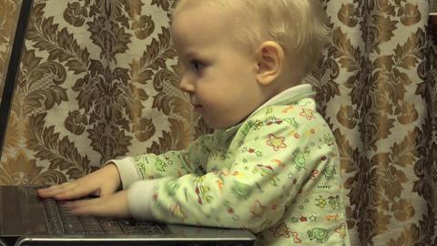 Cute Newborn Little Girl Works Personal Computer. 4K UltraHD, UHD Footage