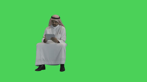 Arabic Adult Male working on Digital Tablet Footage