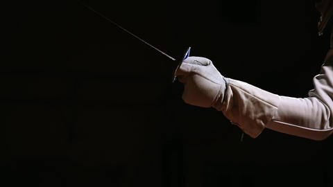 Closeup of a rapier for fencing in the hand performs offensive movements Live Action