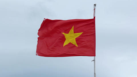 Vietnam flag on a flagpole against the sky Footage