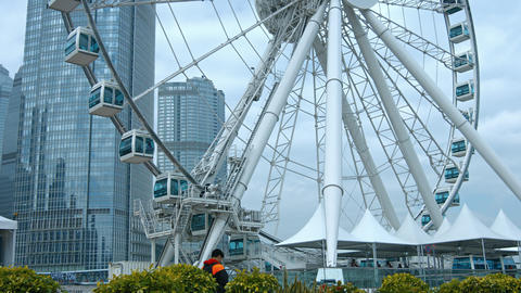 Vertical panorama with Ferris wheel. Hong Kong. China Live Action