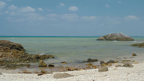 The coast of the tropical sea with rocks in the foreground Footage