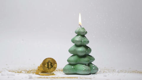 Christmas Tree Candle and Bitcoins against White Background Image