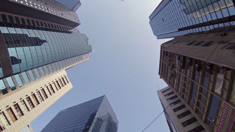 Rotating tops of skyscrapers in the city center. Hong Kong Footage