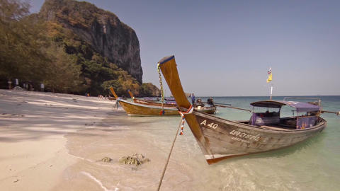 Vintage wooden boats waiting for tourists on paradise beach. Ao Nang. Thailand Footage