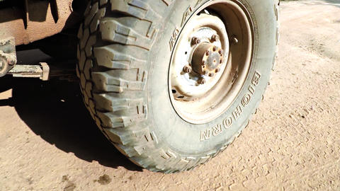 Closeup of All Terrain Tire Rolling over Dirt Track at Yala National Park Footage