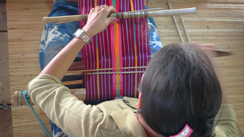 Indonesia. Bali. Local weaver makes tapestry manually Footage