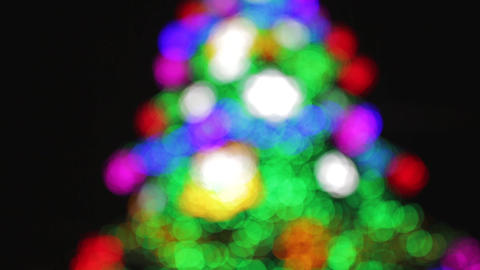 Defocused Christmas tree with colorful bokeh and christmas lights. Christmas and Live Action