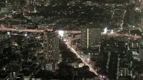 Timelapse Abstract of Heavy Urban Traffic in Downtown Bangkok at Night Footage
